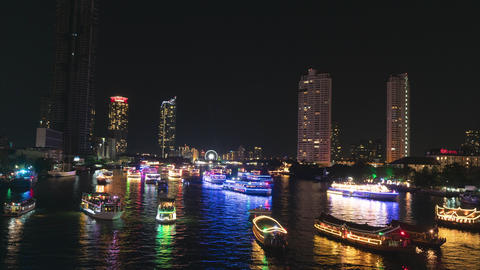 Time lapse, Cityscape view of Chao Phraya River at night with neon ferry waiting for new year Footage