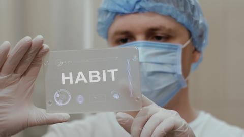 Doctor uses tablet with text Habit Live Action
