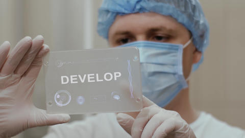 Doctor uses tablet with text Develop Live Action
