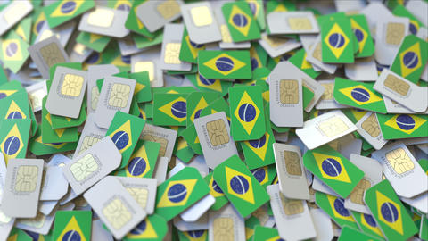 Pile of SIM cards with flag of Brazil. Brazilian mobile telecommunications ビデオ