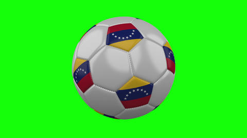Soccer ball with Venezuela flag on green chroma key background, loop Animation