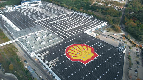 ROYAL DUTCH SHELL logo on a modern industrial complex, conceptual editorial clip Live Action