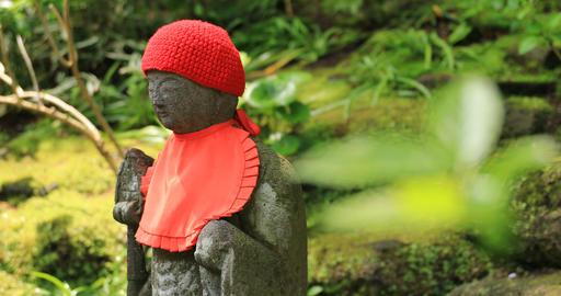 Japanese statue at the traditional guarden at Hokokuji in Kamakura handheld Footage