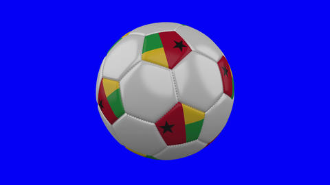 Soccer ball with Guinea-Bissau flag on blue chroma key background, loop Animation