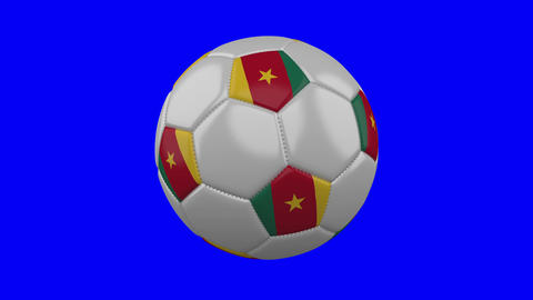 Soccer ball with Cameroon flag on blue chroma key background, loop Animation