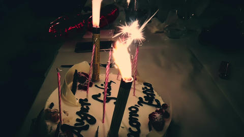 burning sparkler on a birthday cake and with happy birthday written. happy birthday sparkler burning Live Action