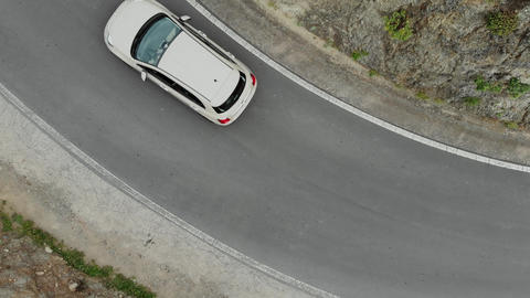 Aerial view. Top down view of the car, turning on the mountain serpentine Footage