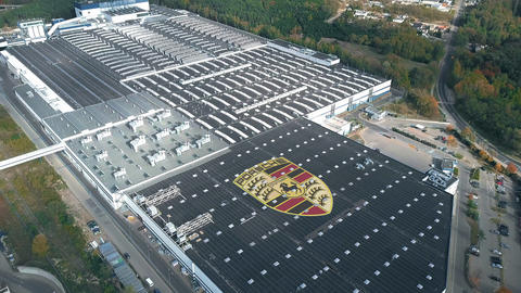 Logo of PORSCHE on the roof of an industrial facility, conceptual editorial clip Footage