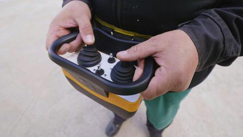 man operates with joysticks of remote controller closeup Footage