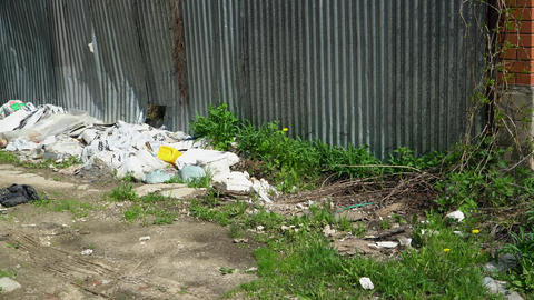 Garbage in the form of plastic and plastic bags, as well as rusty cans Footage