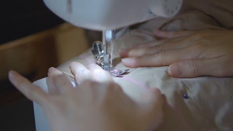 Woman hands of seamstress using a sewing machine, Live Action