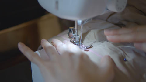Woman hands of seamstress using a sewing machine Stock Video Footage