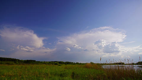 storm clouds are moving over countryside field Footage