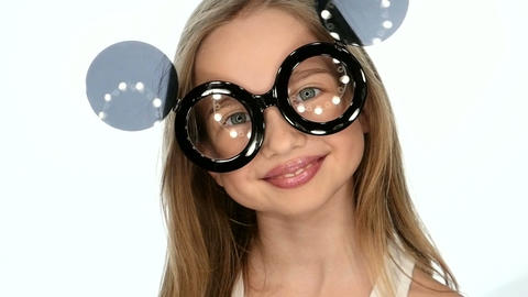 Teen girl posing in funny glasses, slow motion Footage