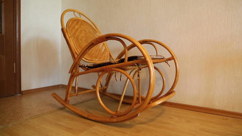 elegant wicker rocking chair sways in the room Footage