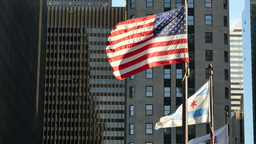 United States and Chicago Flags Waving on Chicago at Sunset Footage