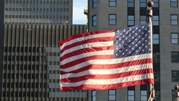 Cinematic United States Flag Waving on Chicago at Sunset Footage