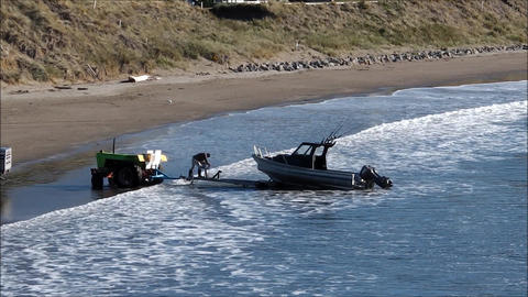 Man winching boat on to trailer Footage