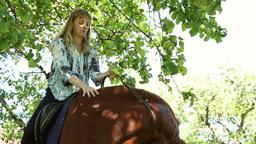 The girl riding a horse