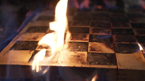 Burning chessboard close-up. Shooting a clip. Slow motion Live Action