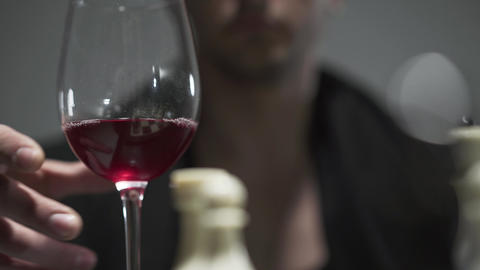 Portrait of an unrecognized man drinking red wine from a wine glass. Leisure of Footage