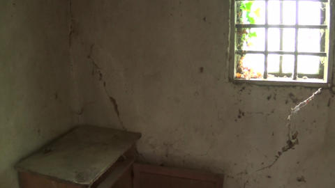 An old chest and a window in the interior of an old and abandoned house Footage