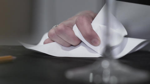 Close-up of the hand of angry man crumples a piece of paper. Aggressive guy has Footage