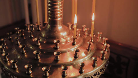 Burning church candles on a candlestick during church services Live Action