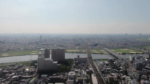 A city with a view of the river and the bridge. Panoramic landscape Footage