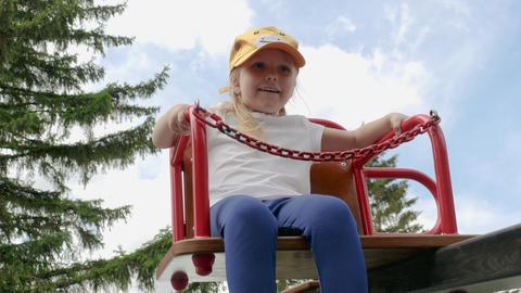 Little Girl Swinging On A Swing Footage