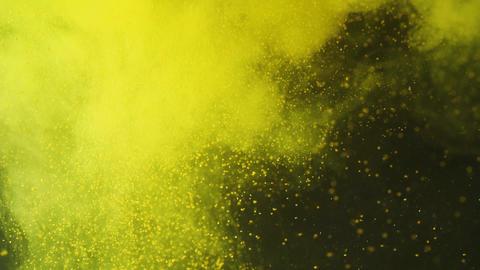 Fresh lemon splashing into the yellow water with pollen.... Stock Video Footage