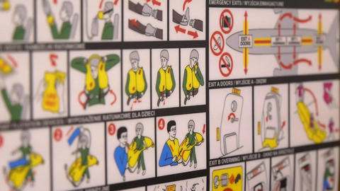 Safety instruction on a seat back of an airplane Footage
