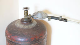 Panning gas tank container gas stove in rustic rural countryside home kitchen Footage