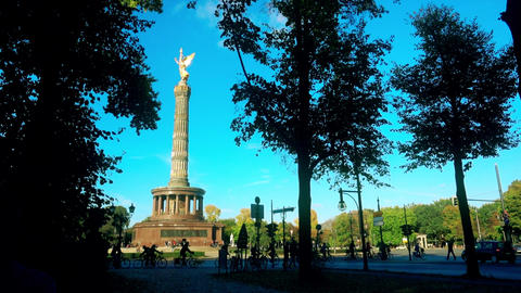 Famous Berlin Victory Column in Tiergarten Park and silhouettes of people and Footage