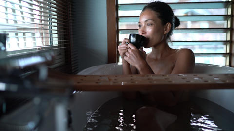 Luxury bath Asian woman relaxing in warm water enjoying view from bathroom Footage