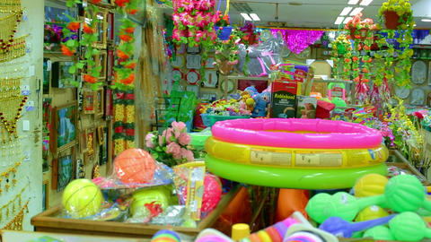 Interior of kids store. Toys for kids on shelves in Indian toy shop. showcase of a jewelry store Footage