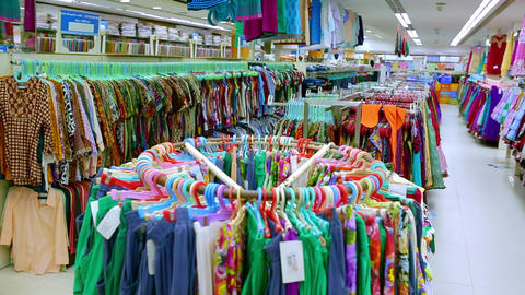 customer shopping in the discount cloth shop, piles of cloth in the store with low price. many cheap Footage