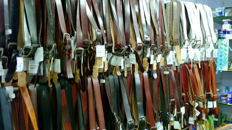 A shop display of mens leather belts Live Action