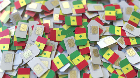 SIM cards with flag of Senegal. Senegalese cellular network related conceptual ビデオ
