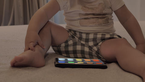 Girl learning colours with cartoon on cellphone Footage