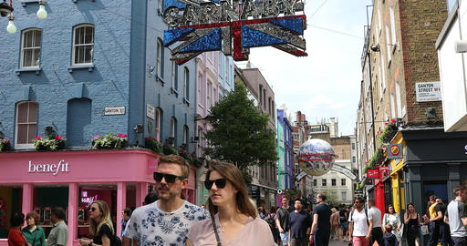 Tourists Walking On Carnaby Street And Ganton Street In London Live Action