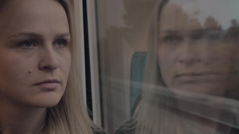Thoughtful woman in the train Live Action