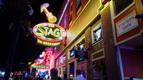 Colorful Nashville Broadway at night - a big party zone - NASHVILLE, USA - JUNE Footage