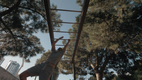 Workout on monkey bar in the park Footage
