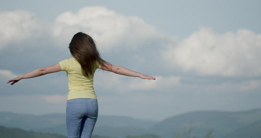 Attractive Young woman having fun outside nature background mountains. Happy Footage