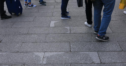 Body parts of walking people at the stone paved road in Asakusa Live Action