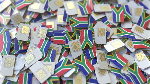 Pile of SIM cards with flag of South Africa. African mobile telecommunications ビデオ