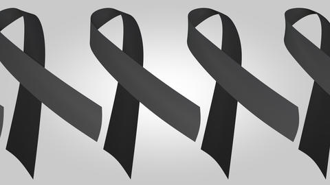 Many black ribbons, a sign of mourning. Loopable motion background Live Action