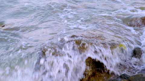 waves of the Black Sea beat against the rocks on the shore, slow motion Acción en vivo