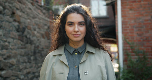 Portrait of beautiful girl being serious then smiling standing outdoors in city Footage
